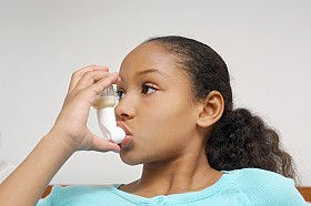 Girl with an asthma inhaler