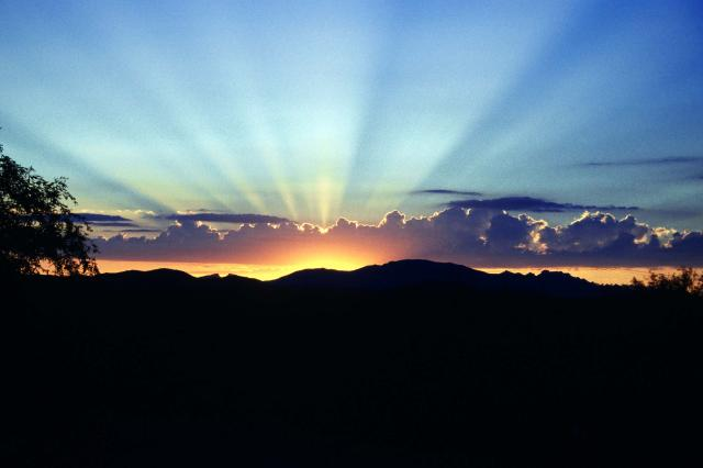 sunrise over a silhouette of the mountains