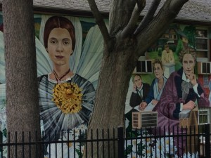 Amherst mural with Emily Dickinson framed by trees