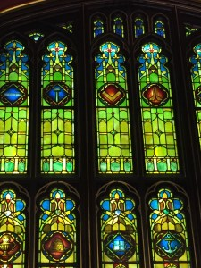 Cathedral-like stained glass in the Renaissance room, depicting mason's tools