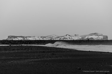 "Hjörleifshöfði viewed from the Black Sand Beach in Vik. Nikon D750, 185 mm (80-400.0 mm ƒ/4.5-5.6) 1/125"" ƒ/5.3 ISO 100"