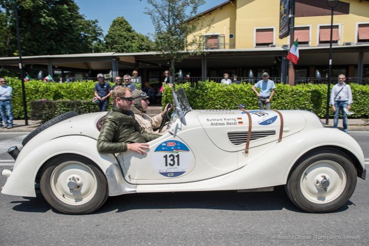 """Andreas Wendt and Burkhard Riering (D) on a 1938 BMW 328. Nikon D810, 24 mm (24.0mm ƒ/1.4) ) 1/680"""" ƒ/4 ISO 64"""
