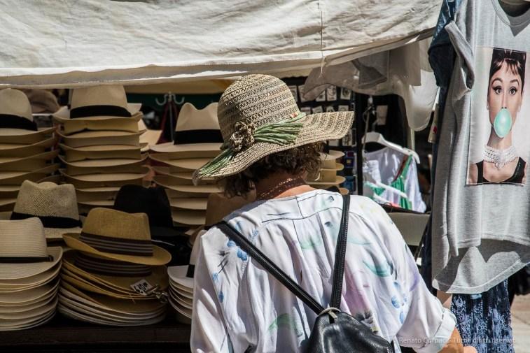 """A woman tourist in Piazza delle Erbe. Nikon D810 120 mm (24-120.0 mm ƒ/4) 1/200"""" ƒ/16 ISO 200"""