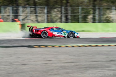 """Andy Prialulx on Ford GT licks the gravel at the exit of the Second Chicane. Nikon D810, 220 mm (80-400.0 mm ƒ/4.5-5.6) 1/125"""" ƒ/11 ISO 64"""