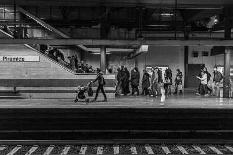 A crowd taking the escalator out of the subway station. Nikon D810, 35 mm (35.0 mm ƒ/2) 1/200 ƒ/4 ISO 12800