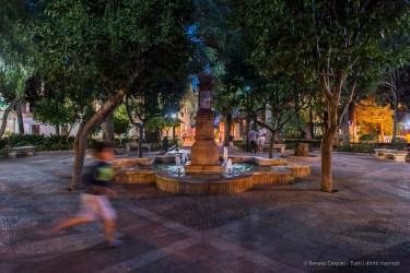 "Just before bedtime. Ronda, a child running across Plaza Duquesa de Parcent. Nikon D810, 24 mm (24.0 mm ƒ/1.4) 1/25"" ƒ/1.4 ISO 1600"