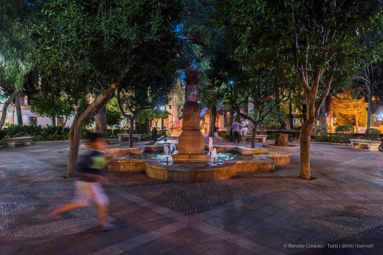 """Ronda, a child running across Plaza Duquesa de Parcent. Nikon D810, 24 mm (24.0 mm ƒ/1.4) 1/25"""" ƒ/1.4 ISO 1600"""