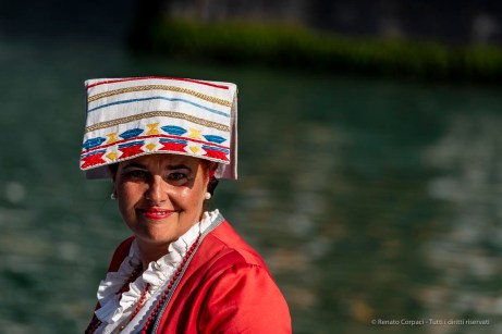 A woman wearing a traditional outfit during the Historical Regatta. Canal Grande, Venice, September 2018