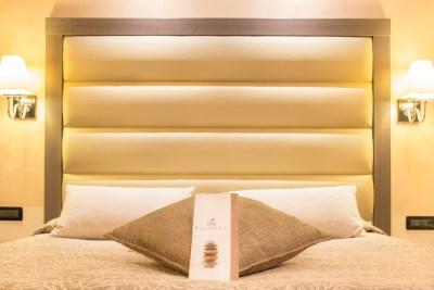 Foto della camera da letto di un hotel a Diano Marina