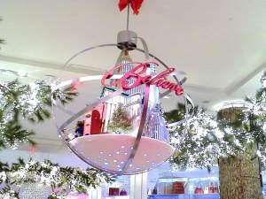 """Another hanging rotating ornament """"Believe"""" in Macy's Herald Square store's main hallway"""