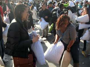 Friends getting into it at Pillow Fight NYC 2015
