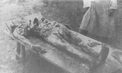 The corpse of Ilya Sidorenko, owner of a fashion store in the city of Sumy. The victim's ribs and arms before death had been broken and the genitals crushed and mutilated.