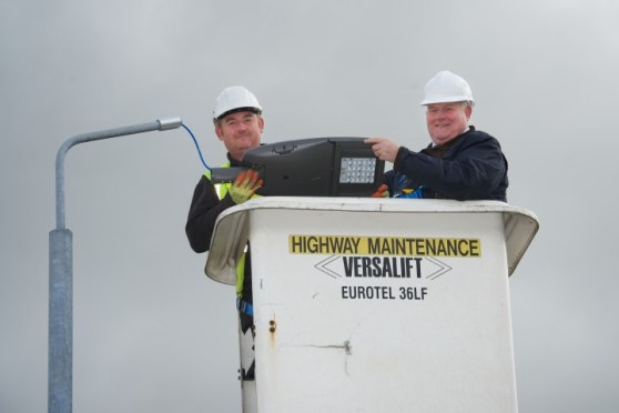Councillor Eddie Devine fitting Erskine LED streetlight