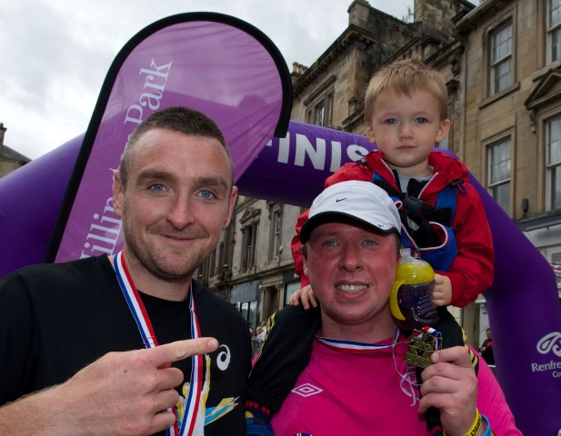 Jay Semple with his son, Tyler James, aged 3, right with his 10k race guide William Robertson