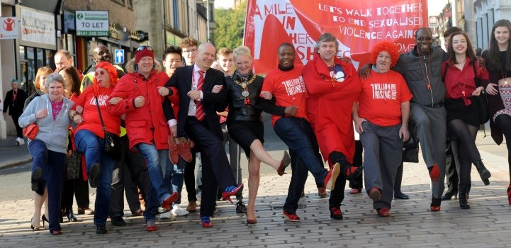 Supporters paint the town red for 'Walk a Mile in Her Shoes' campaign