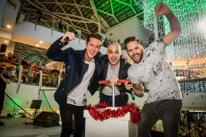 5ive band members, from left, Ritchie Neville, Sean Conlon and Scott Robinson switch on the Christmas lights at intu Braehead.
