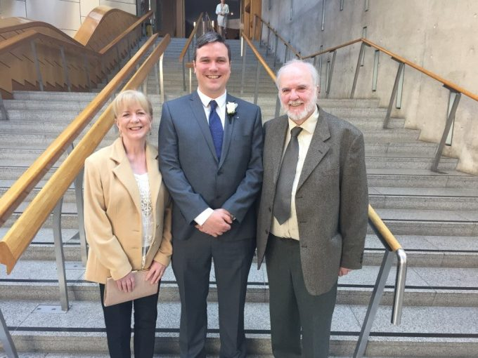 Tom with his Mum, Maureen and Dad, Tom (Senior) in the Scottish Parliament is attached for use. There are no copyright restrictions on use of this photo.