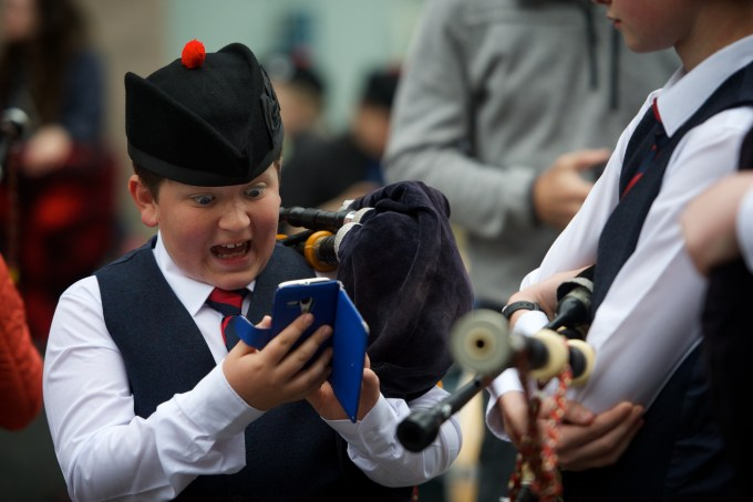 Paisley Piper catches a Pokomon. Ruari Buchan a young piper withe the Johnstone Pipe Band got lucky in Paisley just before performing for the judges at the Paisley Pipe Band Championship. While the others were getting their pipes tuned Ruari had a quick check and bagged himself a Pokomon. Photo Credit: Kieran Chambers