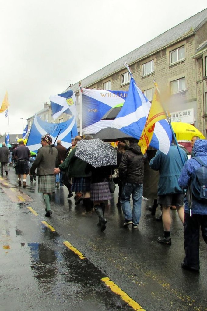 Crowds march in the rain