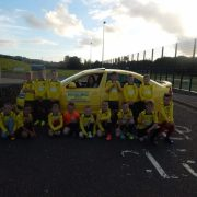 Taxi firm donates cash for youth football team strips