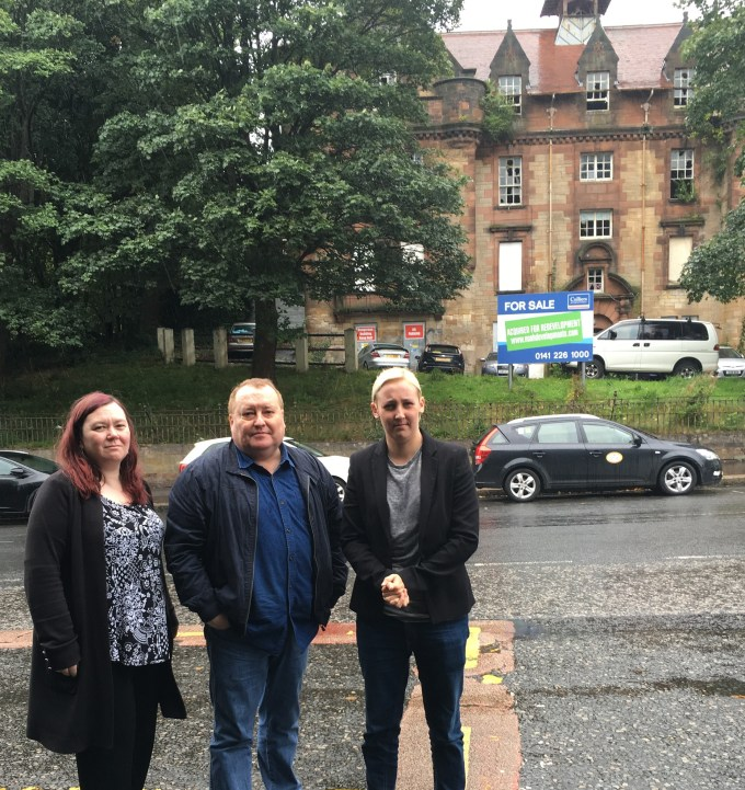 Councillors Kenny and Mags MacLaren along with Mhairi Black MP outside the former TA Hall.