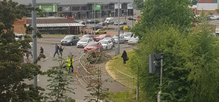 Traffic delays as lorry sheds scaffolding load on road at Abbotsinch Retail Park Paisley