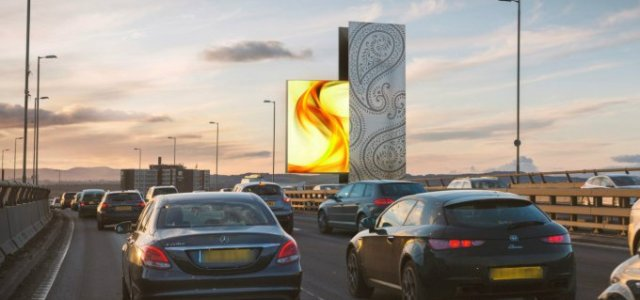 Work to build Scotland's tallest advertising tower on the side of its busiest motorway is underway