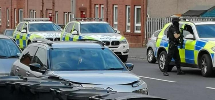 Johnstone street closed after reports of a gun in a flat in MacDowall Street