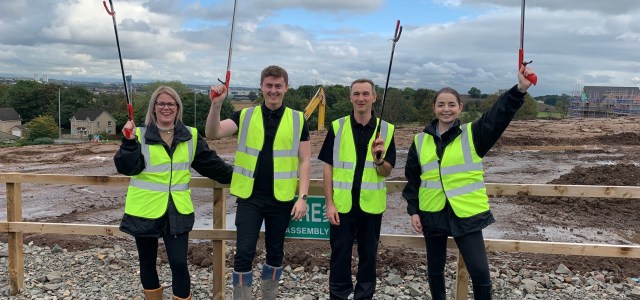 National homebuilder takes part in a community clean up in Erskine