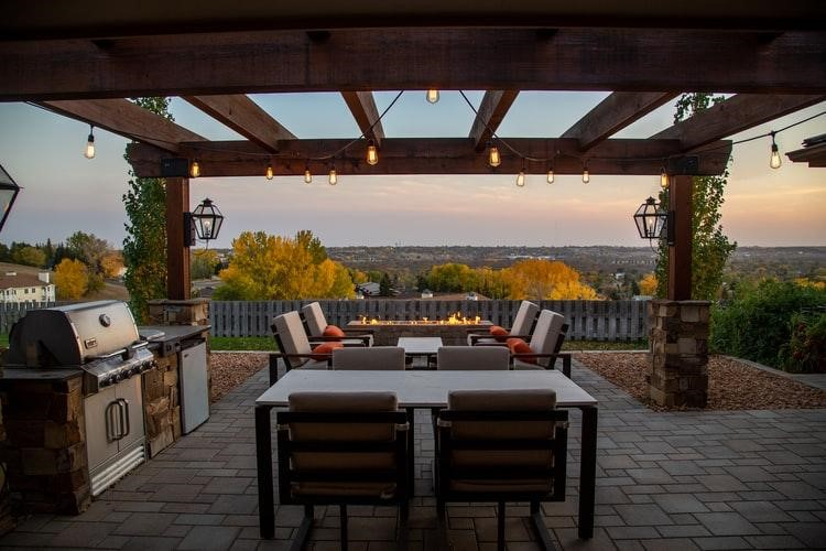 a pergola with fireplace and tv