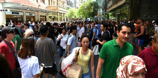 Shoppers are seen in the Central Business District in Sydney, Monday, Dec. 26, 2016. Consumers are expected to spend an estimated $2 billion AUD on post-christmas sales in Australia.(AAP Image/Sam Mooy) NO ARCHIVING