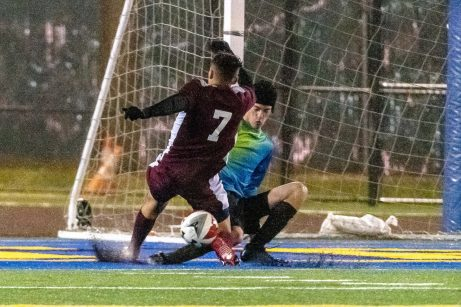 WATERBURY, CT. 07 November 2019-110719BS576 - Woodland goalkeeper Ryan Lamb, right, makes a sliding save on Naugatuck's Lucas Silva (7), during the NVL Boys Soccer final between Naugatuck and Woodland at Municipal Stadium in Waterbury on Thursday. The Naugatuck boys soccer team are the 2019 NVL Champions after beating Woodland 2-1. Bill Shettle Republican-American