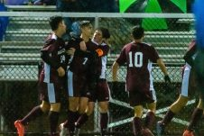 WATERBURY, CT. 07 November 2019-110719BS576 - Naugatuck's Lucas Silva (7) is surrounded by his teammates after scoring a goal, during the NVL Boys Soccer final between Naugatuck and Woodland at Municipal Stadium in Waterbury on Thursday. The Naugatuck boys soccer team are the 2019 NVL Champions after beating Woodland 2-1. Bill Shettle Republican-American