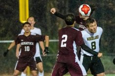 WATERBURY, CT. 07 November 2019-110719BS576 - Woodland's Cole Barrows (8) heads the ball in between Naugatuck players Freddie Longo (3) and Bruno Silva (2), during the NVL Boys Soccer final between Naugatuck and Woodland at Municipal Stadium in Waterbury on Thursday. The Naugatuck boys soccer team are the 2019 NVL Champions after beating Woodland 2-1. Bill Shettle Republican-American