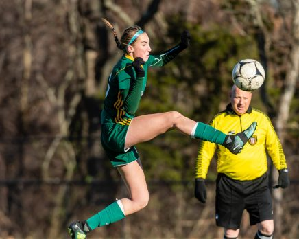 WATERBURY, CT. 16 November 2019-111619BS472 - Holy Cross' Alyssa Hebb (16) controls the ball in mid air, during a Class S quarterfinal match between Coventry and Holy Cross at Crosby High School in Waterbury on Saturday. Holy Cross beat Coventry 3-0 and advances to the Class S semi-finals next week. Bill Shettle Republican-American