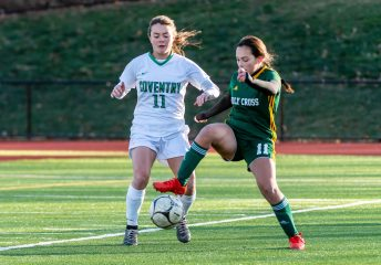 WATERBURY, CT. 16 November 2019-111619BS478 - Holy Cross' Delia Murphy (11) controls the ball in front of Coventry's Anna Picard (11), during a Class S quarterfinal match between Coventry and Holy Cross at Crosby High School in Waterbury on Saturday. Holy Cross beat Coventry 3-0 and advances to the Class S semi-finals next week. Bill Shettle Republican-American