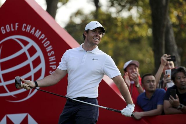Rory McIlroy of Northern Ireland looks out after teeing off for the HSBC Champions golf tournament at the Sheshan International Golf Club in Shanghai on Sunday, Nov. 3, 2019. (AP Photo/Ng Han Guan)