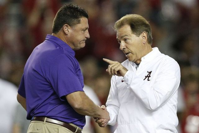 FILE - In this Nov. 4, 2017, file photo, LSU head coach Ed Orgeron, left, and Alabama head coach Nick Saban meet in the center of the field before an NCAA college football game, in Tuscaloosa, Ala. For the first time in college football history, there will be two games matching teams of at least 8-0 on the same day, according to ESPN Facts and Info. In Tuscaloosa, Alabama, LSU and the Crimson Tide will play the first regular-season game matching AP Nos. 1 and 2 since 2011 _ when No. 1 LSU beat No. 2 Alabama 9-6 in overtime. (AP Photo/Brynn Anderson, File)