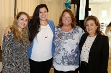From left, Meghan Rickard of Southington, Whitney Cadett of Wolcott, Kathy Rickard of Southington, and Rosemary Briglia of Middlebury attend the Waterbury Chamber annual Business Women's Forum in Southington Tuesday. Steven Valenti Republican-American