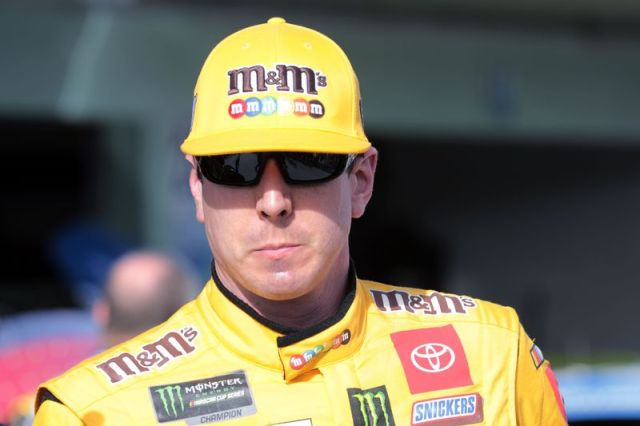 Kyle Busch leaves the garage after a NASCAR Cup Series auto race practice at Homestead-Miami Speedway in Homestead, Fla., Saturday, Nov. 16, 2019. (AP Photo/Luis M. Alvarez)