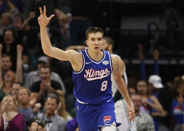 Sacramento Kings guard Bogdan Bogdanovic celebrates after scoring in the closing moments of his team's win over the Boston Celtics in an NBA basketball game in Sacramento, Calif., Sunday, Nov. 17, 2019. (AP Photo/Rich Pedroncelli)