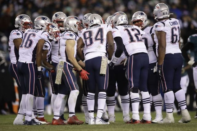 New England Patriots quarterback Tom Brady (12) huddles with teammates during an NFL football game against the Philadelphia Eagles, Sunday, Nov. 17, 2019, in Philadelphia.(AP Photo/Matt Rourke)