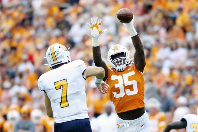 Tennessee linebacker Daniel Bituli (35) bats down a pass from Chattanooga quarterback Nick Tiano (7) during an NCAA college football game in Knoxville, Tenn., Saturday, Sept. 14, 2019. Bituli has earned his teammatesþÄô respect for the way he has fought through injuries and coaching changes to emerge as a steadying force for a program that has dealt with plenty of instability over the years. (Scott Keller/The Daily Times via AP)