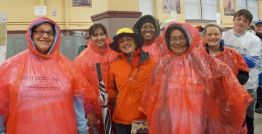 Many runners took advantage of our supply of emergency ponchos before hitting the street!