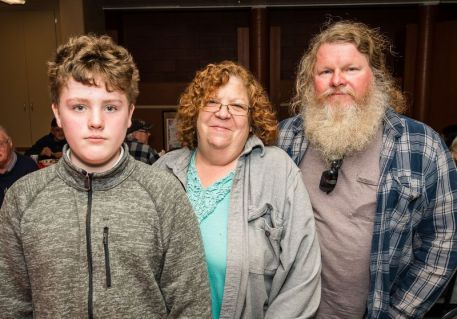 Anthony Hazen, 10, stands with his mother and father Peggy and Ron Hazen all of Waterbury at the Hopeville Church's annual fundraiser dinner and silent auction at the Hopeville Church in Waterbury on Wednesday. Bill Shettle Republican-American