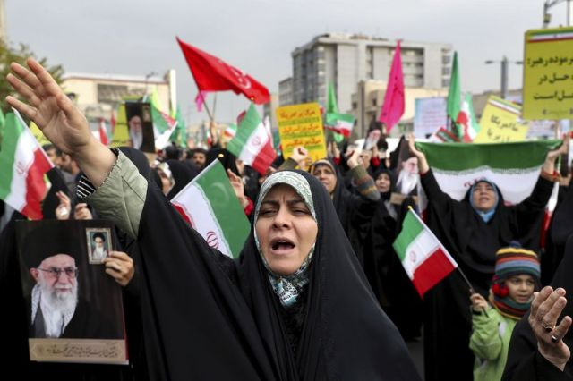 A demonstrator chants slogans during a pro-government rally denouncing last weekþÄôs violent protests over a fuel price hike in Tehran, Iran, Monday, Nov. 25, 2019. (AP Photo/Ebrahim Noroozi)