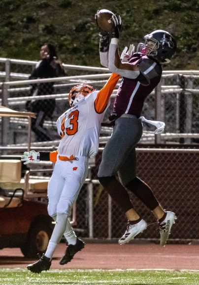NAUGATUCK, CT. 21 November 2019-112119BS404 - Naugatuck's Isaiah Williams (1), right, jumps up and catches the ball over Watertown's Jaeden Goodwine (13), during a NVL Football game between Watertown and Naugatuck at Naugatuck High School on Thursday. Bill Shettle Republican-American