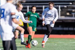 New Britain, CT. 23 November 2019-112319BS961 - Holy Cross' Delia Murphy (11), center, battles for the ball with Old Lyme's Olivia Powers (22), left, and Emily DeRoehn (15), right, during the Girls Soccer Class S final between Old Lyme and Holy Cross at Willowbrook Park in New Britain on Saturday. Bill Shettle Republican-American