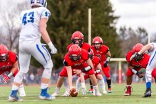 CHESHIRE, CT. 28 November 2019-112819BS1250 - Cheshire quarterback Jason Shumilla (14) gets behind center Dan Bourdeau (51), waiting for the snap, during a SCC game and the annual Cheshire vs Southington Thanksgiving game called the Apple Valley Classic at Cheshire High School on Thursday. Southington won 21-20 in double overtime. Bill Shettle Republican-American