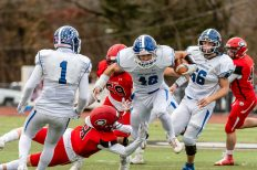 CHESHIRE, CT. 28 November 2019-112819BS1247 - Southington's Dillon Kohl (42), center, runs with the ball through the attempted tackle by Cheshire's Colby Griffin (8), during a SCC game and the annual Cheshire vs Southington Thanksgiving game called the Apple Valley Classic at Cheshire High School on Thursday. Southington won 21-20 in double overtime. Bill Shettle Republican-American